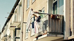 Low Angle View of Clothes Hanging on Balcony Royalty Free Stock Images