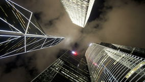 Low angle view of clouds moving over tall office buildings stock video footage