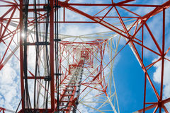 Low angle view of communication tower. Bottom view of a communication tower with blue sky background Royalty Free Stock Photography