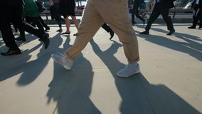 Low angle view of commuters legs. Slow motion low angle view of commuters legs at rush hour on london bridge london themes of routines on the move commuters rush stock video footage