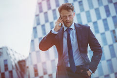 Low angle view of confident businessman speaking on mobile phone Stock Images