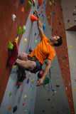 Low angle view of confident man wall climbing Stock Images