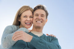 Low Angle View Of Couple Against Clear Sky Royalty Free Stock Photos
