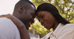 Low angle view of couple embracing and talking stock video footage