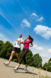 Low angle view of couple running outdoors Royalty Free Stock Image