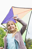Low angle view of cute girl with a kite Royalty Free Stock Image