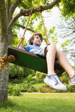 Low angle view of a cute little boy on swing Royalty Free Stock Photography