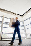 Low angle view of delivery woman Stock Images
