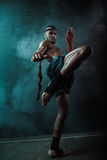 Low angle view of determined Muay thai fighter training thai boxing Royalty Free Stock Photography
