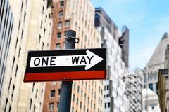 Low angle view of directional sign against buildings in New York. Low angle view of directional sign against buildings in city Stock Photo