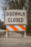 Low Angle View of Dirty Sidewalk Closed Sign Stock Images