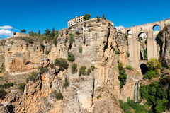 Puente Nuevo bridge and white houses in Ronda, Spain. Low-angle view of the famous Puente Nuevo new Bridge over the Guadalevin river in the Andalusian village of Stock Image