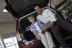 Low angle view of father and son sitting in car Royalty Free Stock Photo