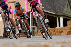 Low-Angle View Of Female Cyclists Leaning Into Turn Stock Photo