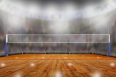 Volleyball arena with copy space. Low angle view of fictitious volleyball arena with sports fans in the stands and copy space. Focus on foreground with stock images