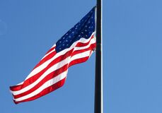Low Angle View of Flag Against Blue Sky Royalty Free Stock Photos