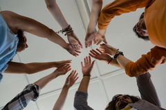 Low angle view of friends with arms raised Royalty Free Stock Image