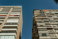 Low angle view of generic apartment building facade. Stock Image