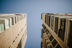 Low angle view of generic apartment buildings, with blue sky in the background. Stock Photography