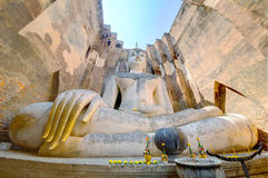 Low angle view of a giant ancient Buddha statue in Temple Wat Si Chum in Sukhothai Historical Park, Thailand Stock Images