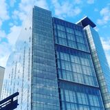 Low Angle View of Glass High Rise Building during Cloudy Daytime Photo Royalty Free Stock Image