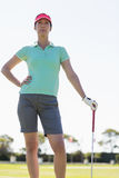 Low angle view of golfer woman Stock Photos
