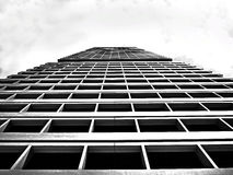 Low Angle View on Grey High Rise Building Under White Sky Stock Images
