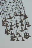 Low angle view of hanging bells with the sky in the background Royalty Free Stock Photo