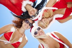 Low angle view of happy girls in christmas suit Stock Images