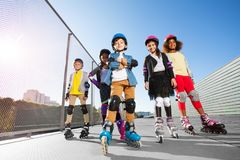 Happy multiethnic kids in rollerblades  outdoors Stock Photo