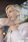 Low angle view of happy woman holding coffee cup Stock Photo