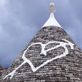 Low angle view of a heart shape painted on a trulli house Stock Photo