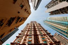 Low angle view of high-rise residential towers with crowded narrow apartments. In a community near Central-Mid-Levels Escalator & Walkway system in Hong Kong, a royalty free stock photography