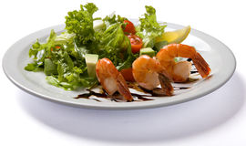 Salad with shrimp served on white plate Royalty Free Stock Photos