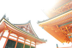 Low angle view of Japanese architecture buildings and roof details of pagoda against white sky at a Buddhist temple in Kyoto, Japa. N royalty free stock images