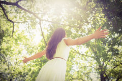 Low angle view of long hair woman with arms outstretched Royalty Free Stock Images