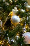 Decorated and Lighted Christmas Tree Close Up. Low angle view looking up decorated and lighted Christmas tree Stock Image