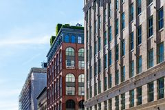 Luxury apartment buildings in Tribeca in New York. Low angle view of luxury apartment buildings in Tribeca North District of New York City stock photos