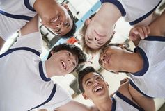 Low Angle View Of Male High School Basketball Players Having Team Talk stock photo