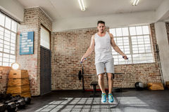 Low angle view of man doing skipping Stock Photo