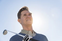Low Angle View Of Man Holding Golf Club Against Sky Stock Photos