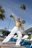 Low angle view of man impersonating Elvis Presley Royalty Free Stock Photography