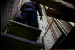 Low angle view of  man riding up a construction elevator stock video footage