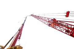 Mobile crane with tower crane on studio. Low angle view of mobile crane with tower crane, isolated on white background Stock Photos