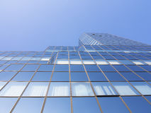 Low angle view of modern office building. Blue sky Stock Image