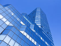 Low angle view of modern office building. Blue sky Stock Photography