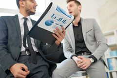 Discussing Statistics with Colleague stock photography