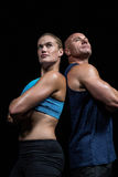 Low angle view of muscular man and woman Stock Image