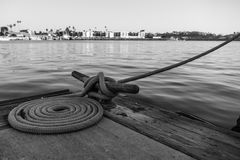 Black and White Dock Tie Off Rope on cleat Royalty Free Stock Image
