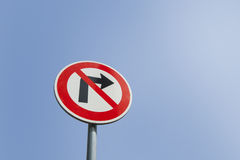 Low angle view of no right turn sign against clear sky Royalty Free Stock Photos